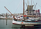 Betty with lifted jib boom in Brighton Marina